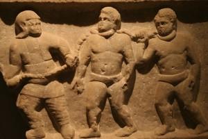 A Roman soldier leading captive slaves.